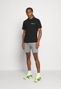 Calvin Klein Jeans - SKATER PHOTO NEON TEE - Print T-shirt - black - 1