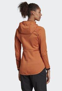 adidas Performance - TERREX CLIMAHEAT HOODED FLEECE - Fleece jacket - brown - 2