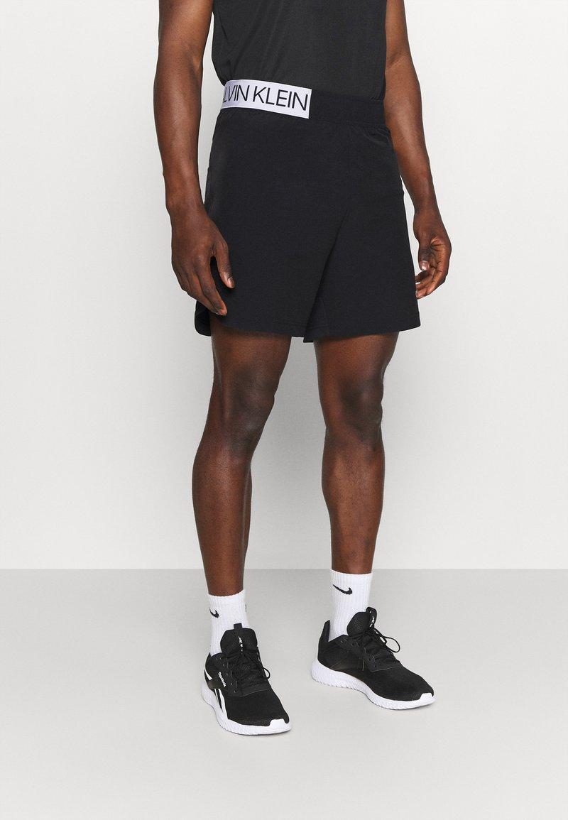 Calvin Klein Performance - SHORTS - Sports shorts - black
