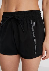 Reebok - MEET YOU THERE TRAINING SHORTS - Sports shorts - black - 4