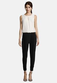 Vera Mont - MIT CUT-OUTS - Jumpsuit - black/cream - 0