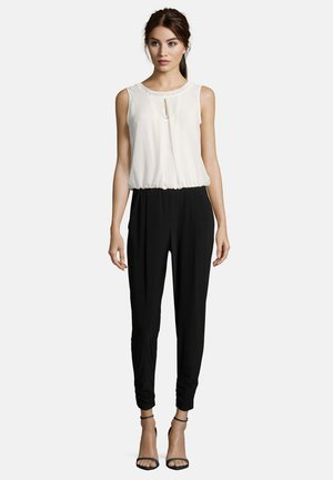 MIT CUT-OUTS - Jumpsuit - black/cream