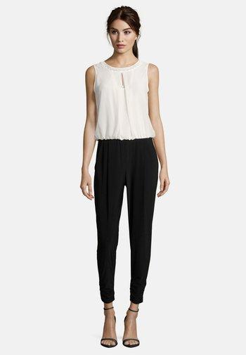 MIT CUT-OUTS - Jumpsuit - black/cream