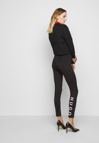 HUGO - Leggings - Trousers - black - 2