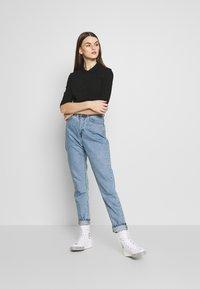 Lacoste - Polo shirt - black - 1