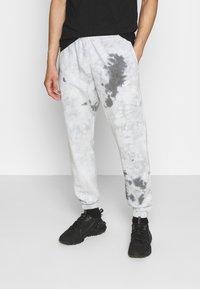 Nike Sportswear - Tracksuit bottoms - smoke grey/iron grey/white - 0
