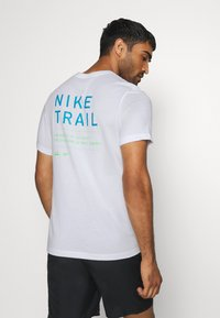 Nike Performance - DRY TEE TRAIL - Print T-shirt - white - 2