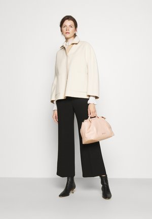 PETIT DRAPPE - Handbag - amande