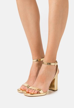 ANGELA ANKLE STRAP - High heeled sandals - gold