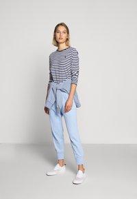 Polo Ralph Lauren - FEATHERWEIGHT - Pantalon de survêtement - elite blue - 1