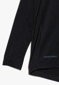 Nike Performance - B NP LS FTTD TOP - Funktionsshirt - black - 4