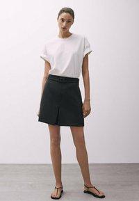 Massimo Dutti - MIT SCHNALLE - A-line skirt - black - 1