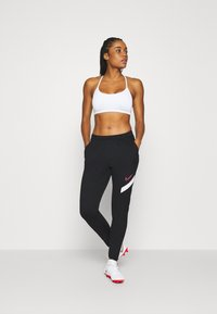 Nike Performance - DRY ACADEMY 20 PANT - Tracksuit bottoms - black/white/hyper pink - 1