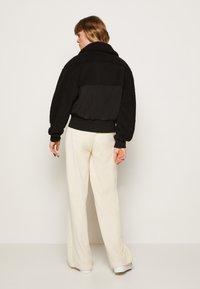Calvin Klein Jeans - POLAR SHORT JACKET - Winter jacket - black - 2