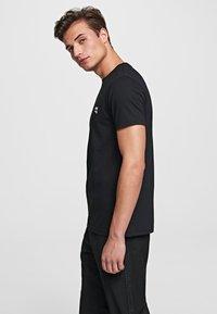 KARL LAGERFELD - IKONIK - Basic T-shirt - black - 3