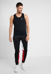 Tommy Sport - GRAPHIC LOGO CUFF - Tracksuit bottoms - black - 1