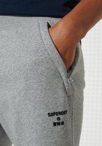 Superdry - Tracksuit bottoms - grey marl - 2