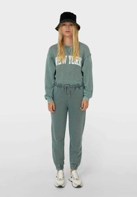 Stradivarius - Tracksuit bottoms - mottled teal - 1