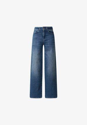 CLEO  - Flared Jeans - medium blue denim