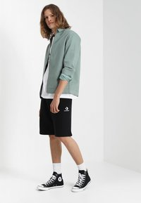 Converse - STAR CHEVRON  - Pantalones deportivos - black - 1