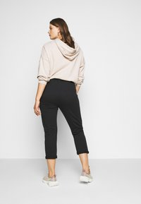 Anna Field Curvy - Tracksuit bottoms - black - 2