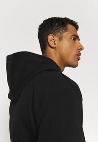 Karl Kani - SIGNATURE HOODIE - Sweat à capuche - black/white - 3