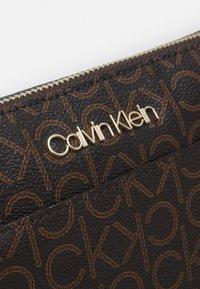 Calvin Klein - XBODY MONOGRAM - Taška spříčným popruhem - brown - 3