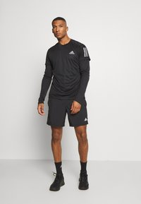 adidas Performance - RESPONSE RUNNING SHORT SLEEVE TEE - T-shirt z nadrukiem - black - 1