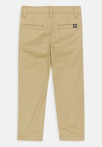 Timberland - TROUSERS - Trousers - stone - 1