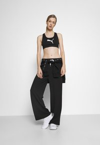 Puma - MODERN SPORTS WIDE PANTS - Trainingsbroek - black - 1
