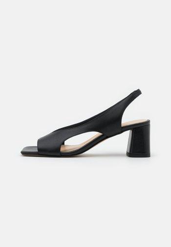 CASIS - Sandals - noir