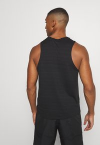 Nike Performance - MILER TANK - Sports shirt - black/silver - 2