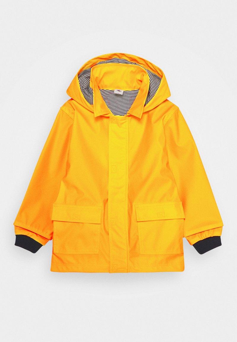 Petit Bateau - FATAH CIRE UNISEX - Regnjakke / vandafvisende jakker - jaune