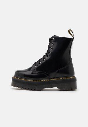 JADON ZIP - Platform ankle boots - black/yellow