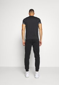 Ellesse - OSTERIA - Tracksuit bottoms - black - 2