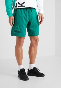 Reebok - OST EPIC GRAPHIC - Sports shorts - green - 0