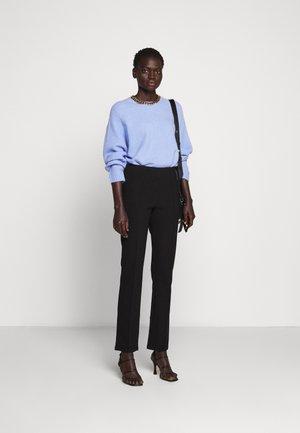 CHRISTAH - Pantaloni - black