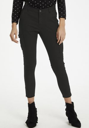 KAMANDY - Trousers - black deep