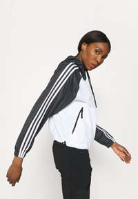 adidas Performance - STRIPES WINDBREAKER - Outdoor jacket - white/black - 3