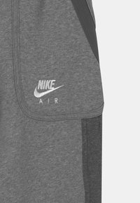 Nike Sportswear - AIR - Tracksuit bottoms - carbon heather/charcoal heathr/white - 2
