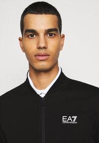 EA7 Emporio Armani - Zip-up hoodie - black - 6