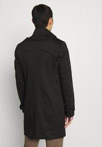 DRYKORN - SKOPJE - Short coat - black - 2