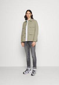 Calvin Klein Jeans - SLIM FIT - Slim fit jeans - denim grey - 1