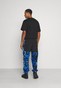 The North Face - DENALI PANT - Spodnie treningowe - clear lake blue - 2