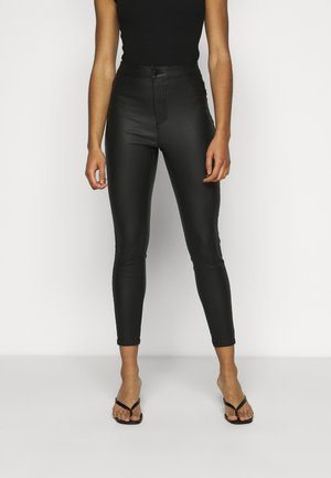 VMJOY SKINNY COATED PANTS - Trousers - black