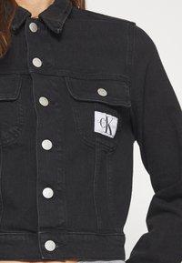Calvin Klein Jeans - CROP TRUCKER - Denim jacket - washed black - 5