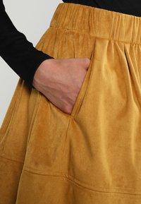 Moves - KIA - A-line skirt - mustard yellow - 3