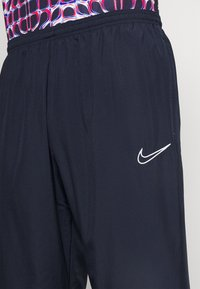 Nike Performance - PANT - Pantalon de survêtement - obsidian/white - 4