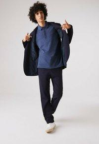 Lacoste - Polo shirt - bleu chine - 1