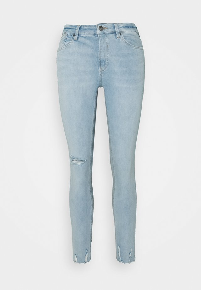 Skinny džíny - blue light wash